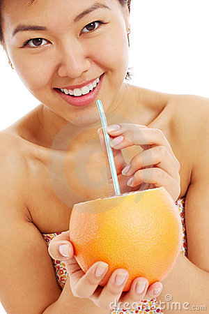 Free Pretty Asian Young Woman With Grapefruit Royalty Free Stock Photos - 24065448