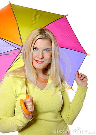 Pretty autumn woman standing under umbrella