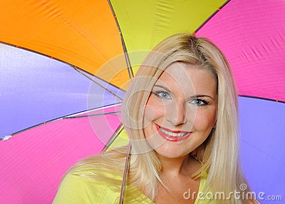 Pretty autumn woman standing under umbrella