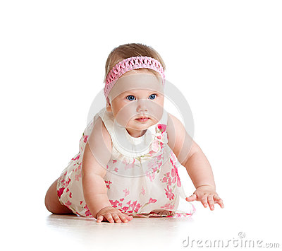 Pretty baby girl crawling on floor