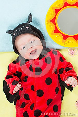 Pretty baby girl, dressed in ladybug costume