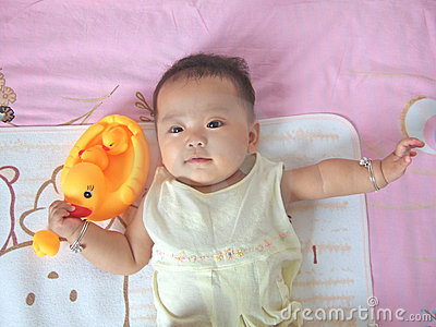 Pretty baby and toy ducks