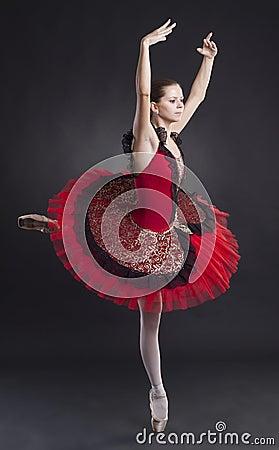 Pretty ballerina posing in a red tutu