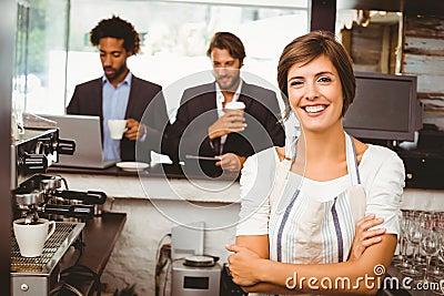 Pretty barista smiling at camera