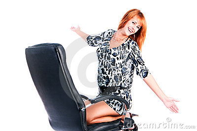 Pretty beautiful young girl on armchair
