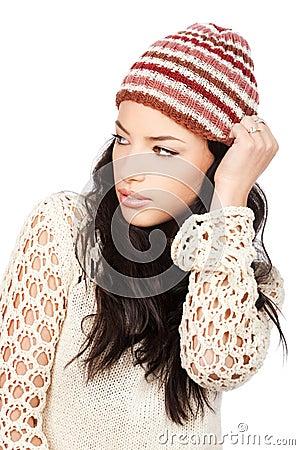 Pretty black hair woman holding her cap