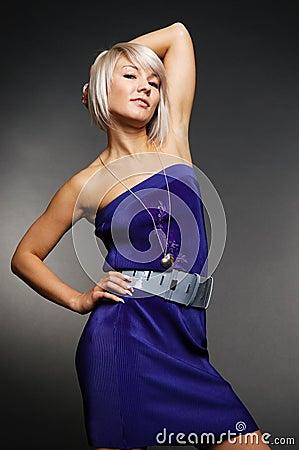 Pretty blond posing against grey background