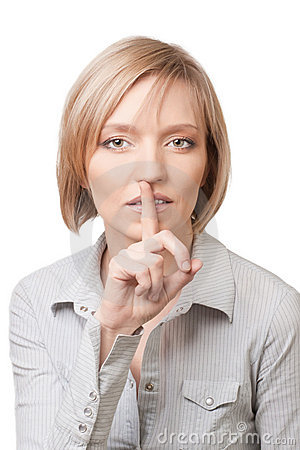 Pretty blond woman with finger on her lips