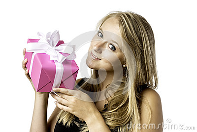 Pretty blond young girl with a present