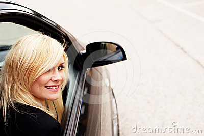 Pretty blonde automobile passenger