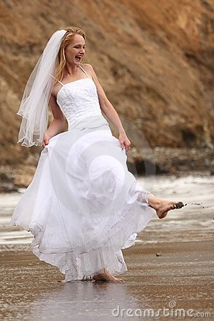 Pretty Blonde Bride Along the Ocean