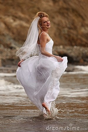 Pretty Blonde Bride Along the Ocean