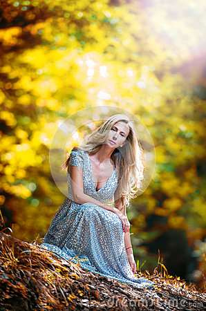 Pretty blonde fairy lady with white dress