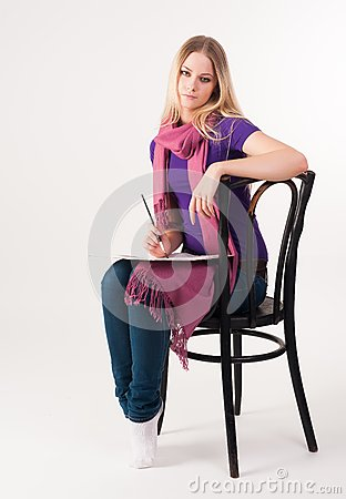 Pretty blonde girl on chair