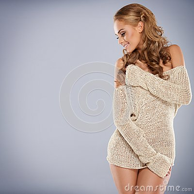Pretty blonde girl posing while isolated