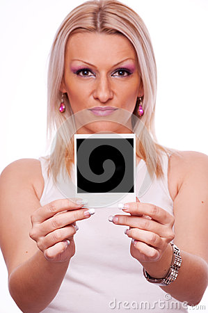 Woman holding blank instant photo frame