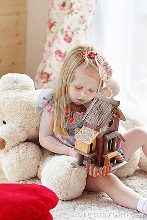 Free Pretty Blonde Little Girl Sits On Carpet Near Window Stock Images - 42649844