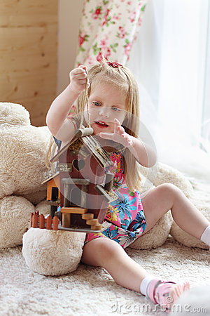 Free Pretty Blonde Little Girl Sits On Carpet Near Window Royalty Free Stock Photography - 42649847