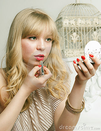 Pretty blonde tint the lips Stock Photo