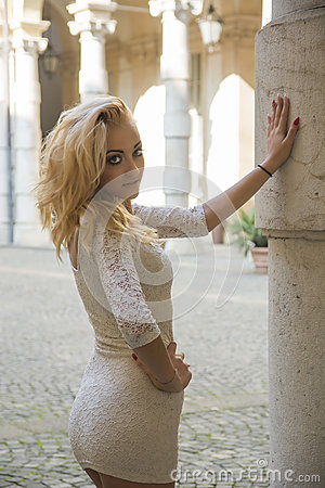 Free Pretty Blonde Young Woman Against Marble Pillar In European City Royalty Free Stock Photos - 50034018