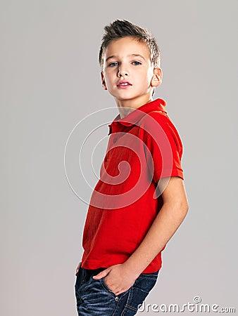 Pretty boy posing at studio as a fashion model.