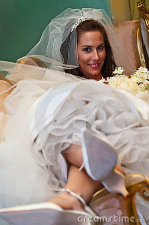 A Pretty Bride Lounging Backward in a Settee
