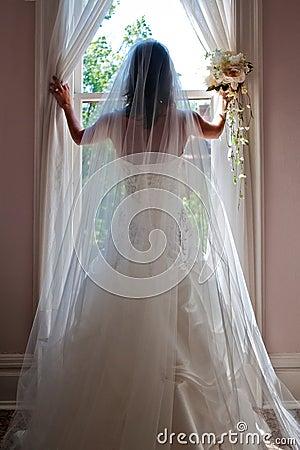 A Pretty Bride Posing With Boquet & Ring