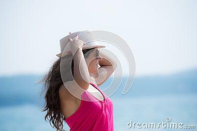 Pretty brunette posing  near the seaside