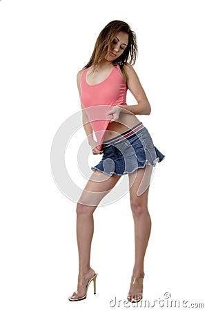 Pretty brunette in sexy mini skirt