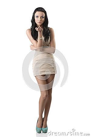 Pretty brunette with short dress sending a kiss