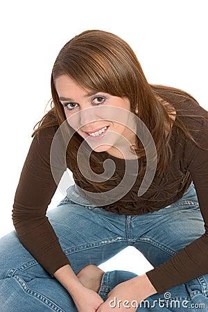 Pretty brunette sitting crosslegged