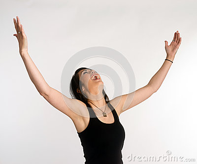 Pretty Brunette Woman Holds Arms Outstretched Jubilant Looking Up Stock Photo
