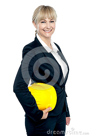 Pretty business architect with yellow safety helmet in hand
