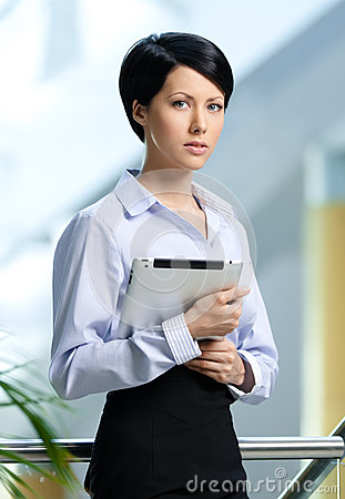 Pretty business woman with tablet