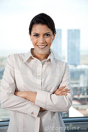 Pretty Businesswoman With Arms Crossed