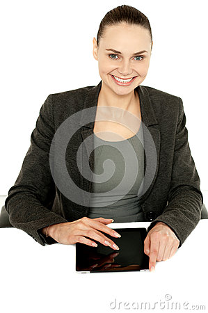 Pretty businesswoman using tablet device