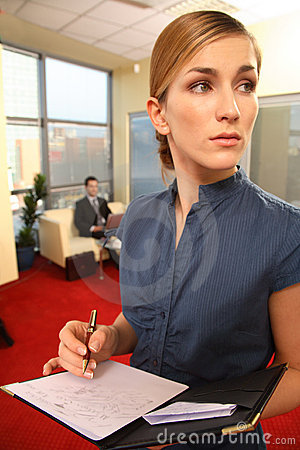 Pretty Businesswoman Writing Notes
