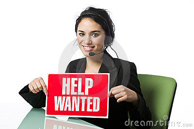 Pretty call service rep with a Help Wanted Sign