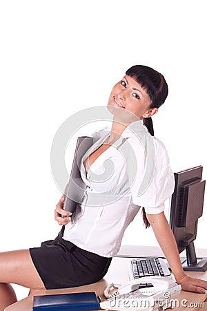 Pretty Caucasian business woman at office desk