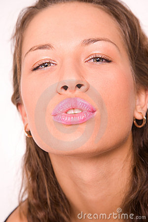 Pretty caucasian girl making a kiss