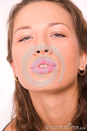 Pretty caucasian girl making a kiss