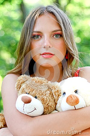 Pretty caucasian young woman with toys