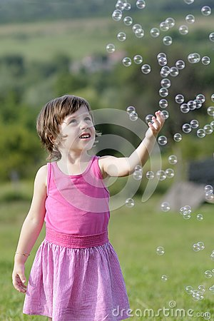 Pretty child catching balloons