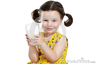 Pretty child holding a big glass of milk