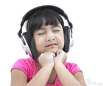 Pretty child listening to music