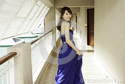 Pretty Chinese girl with blue full dress