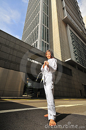 Pretty Chinese Woman in Karate stance on street
