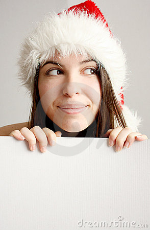 Pretty Christmas girl behind a blank board