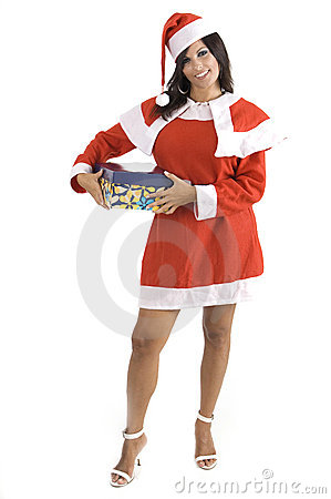 A pretty Claus woman at Christmas holding a gift b