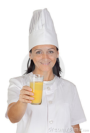 Pretty cook girl with a glass of orange juice